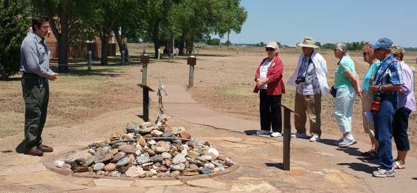 Manger Aaron Roth discusses the memorial composed of the objects brought from all parts of the Navajo country